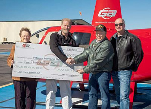 The Veterans Memorial Plaque Committee received a a $2,000 check for a matching pledge donation from Guidance Aviation at the Prescott Airport. From left are VMPC Co-Chair Betty Bougault; President/CEO John Stonecipher with Guidance Aviation; VMPC Co-Chair Phil Goode; and Guidance Aviation Marketing Director Guy Roginson. (Courtesy photo)