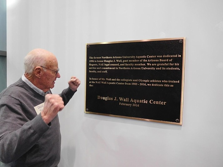 Prescott Valley resident Douglas J. Wall is exuberant is seeing the plaque dedicating the aquatic center at Northern Arizona University in his honor. The Aquatic and Tennis Complex had its grand opening Feb. 19 during ceremonies when Wall was honored.