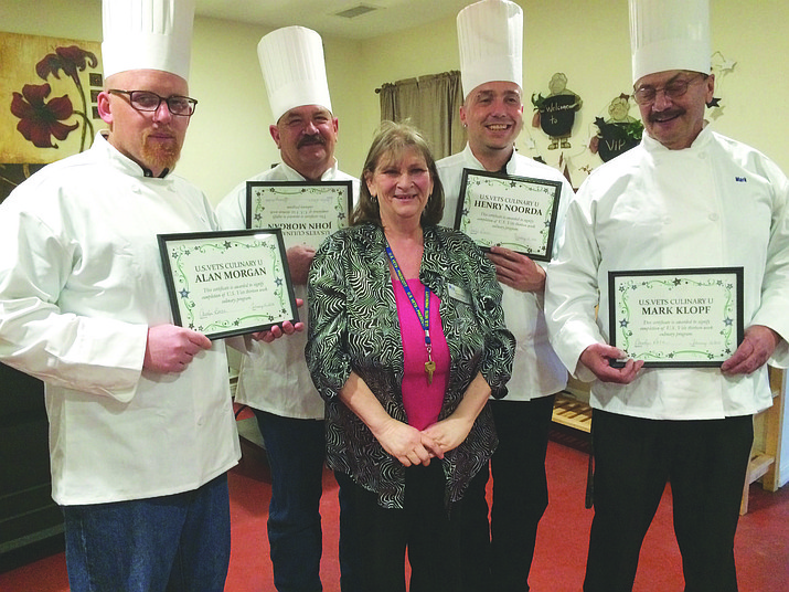 The graduation class of the U.S. Vets culinary program: Left to right: Alan Morgan, John Morgan, Food Services Director Carolyn Baca, Henry Noorda and Mark Klopf.