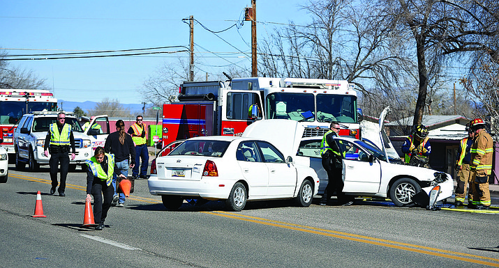 Chino Valley police and firefighters work the scene of a two-vehicle collision near the intersection of Highway 89 and Road 1 North Jan. 26 in Chino Valley. The crash resulted in serious injuries and renewed discussion about the need for a signal at the busy corner.