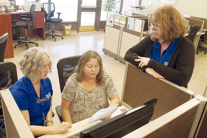 Melissa Koel works with Janet Drozda at the Goodwill Career Center in Prescott as Dee Skipton offers some resume-building tips on Feb. 19. The center is an example of a nonprofit working with businesses to connect employers with qualified job-seekers. (Les Bowen/The Daily Courier)