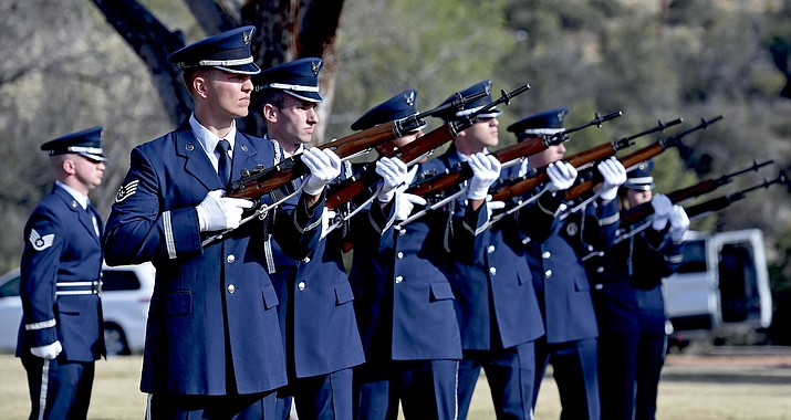 """Members of the Davis–Monthan Air Force Base Honor Guard fire their rifles for the 21-gun salute Tuesday morning at the Prescott National Cemetery during the funeral for Air Force Brigadier General Duane Harold """"Leif"""" Erickson in Prescott."""