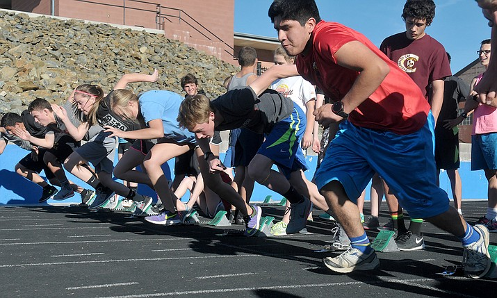 Members of the Prescott High School track team practice their starts Tuesday, Feb. 16, at PHS.