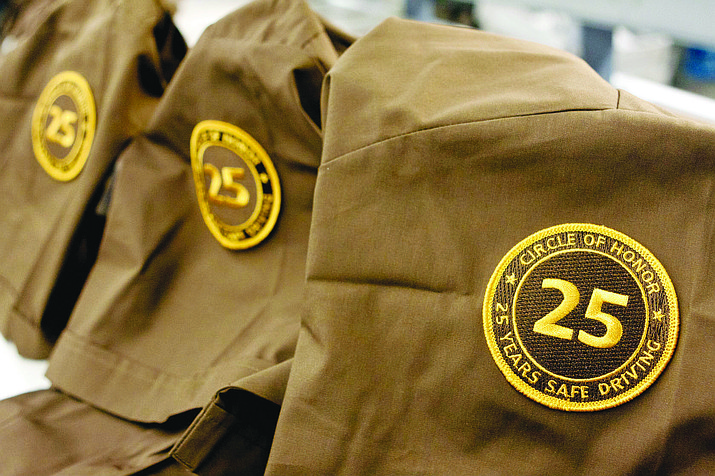 "UPS ""Circle of Honor"" badge attached to driver uniforms."