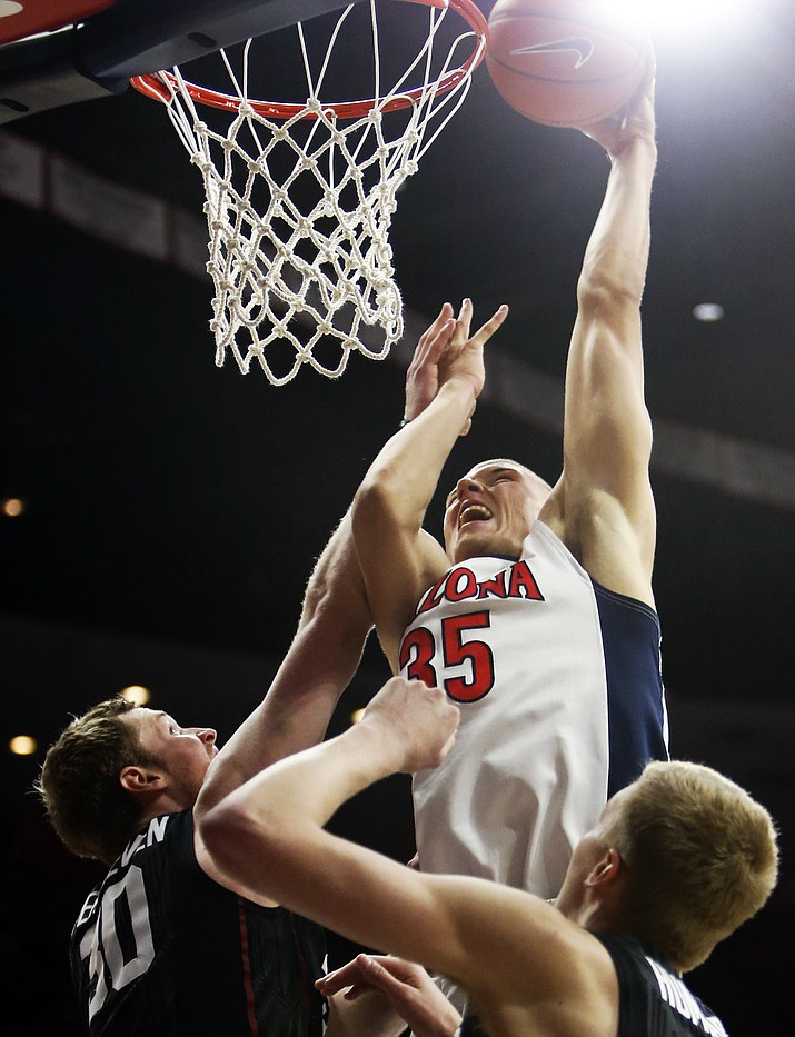 Arizona center Kaleb Tarczewski (35) dunks over Stanford center Grant Verhoeven (30) during their NCAA college basketball game Saturday, March 5, in Tucson. Arizona defeated Stanford 94-62. Tarczewski is one to watch during the Pac-12 tourney, which begins Wednesday.