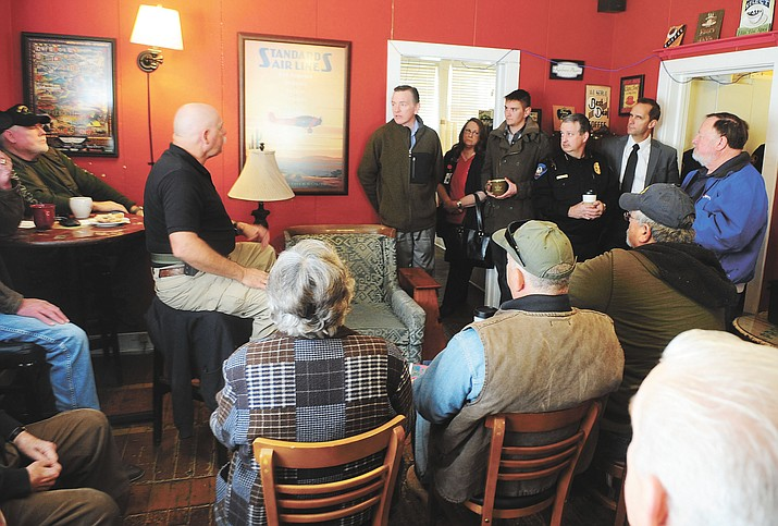 "Congressman Paul Gosar, center, answers questions from Prescott area residents during a ""Congress, Cops & Coffee"" event at Cuppers Coffee Wednesday morning."