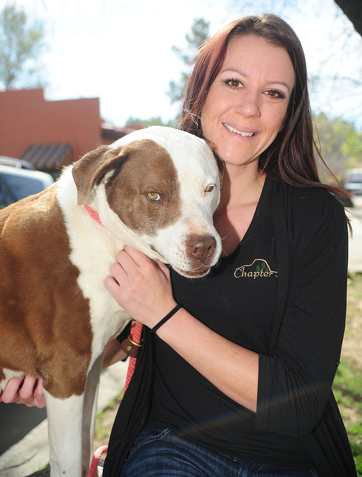 Chapter 5 staff member Jessica Ruttle and her dog, Maya Moo, pose outside the Chapter 5 offices in Prescott Wednesday morning.
