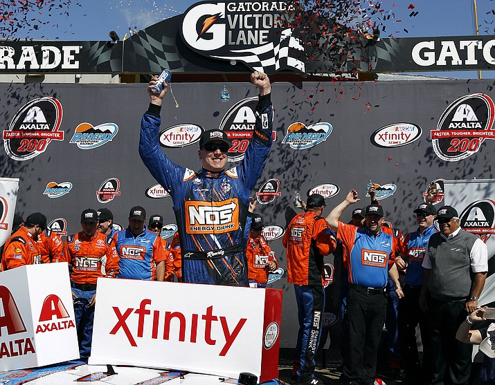 Kyle Busch celebrates in victory lane after winning the NASCAR Xfinity Series auto race at Phoenix International Raceway, Saturday, March 12, 2016, in Avondale, Ariz.