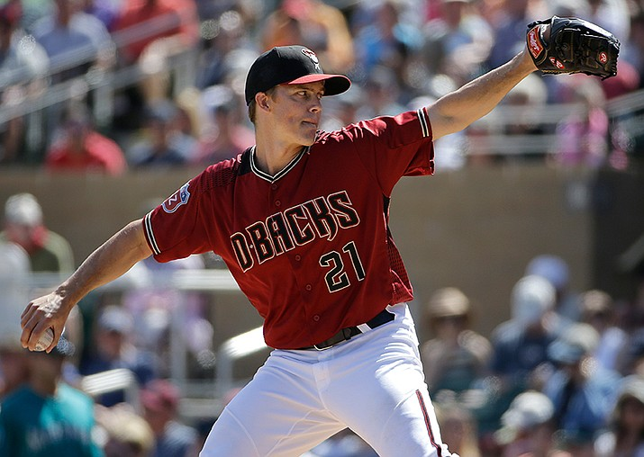 Arizona Diamondbacks' Zack Greinke throws against the Seattle Mariners during their spring training baseball game in Scottsdale on Monday, March 14.