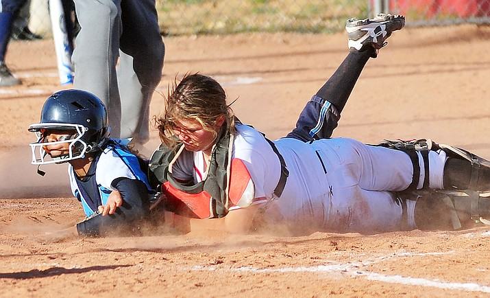 Bradshaw Mountain's catcher Katie Grandy tries to tag out a Window Rock runner at home as the Lady Bears take on the Window Rock Lady Scouts Tuesday afternoon in Prescott Valley. (Les Stukenberg/The Daily Courier)