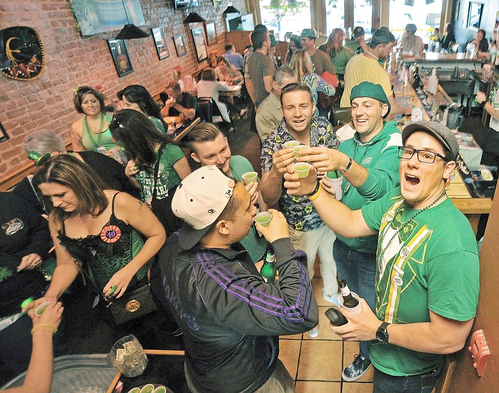 Pub crawlers take shots and fill the El Charro Restaurant and Cantina during the 2015 St. Patrick's Day Pub Crawl in downtown Prescott.