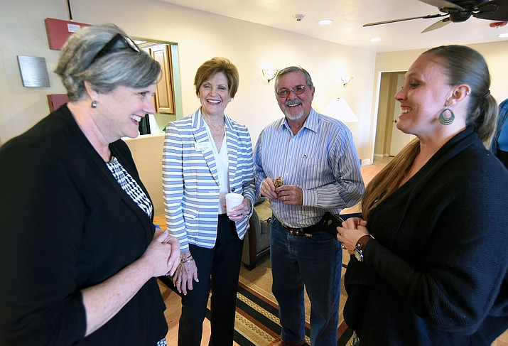 Yavapai County Supervisor Rowle Simmons chats with from left, Catholic Charities' Tami Bohannon Vice President for Advancement, Kathy Sischka Board Member, and Camie Rasband, Housing Supervisor, about their new Veteran's home on Willow Creek Road Tuesday evening during their open house for the home in Prescott.  (Matt Hinshaw/The Daily Courier)
