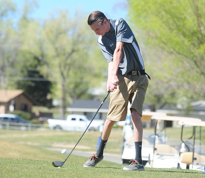 Chino Valley golfer Jared Minkus tees off on the first hole of the Antelope Hills Golf Course as they face Kingman, River Valley and Wickenburg Thursday afternoon in Prescott. (Les Stukenberg/The Daily Courier)