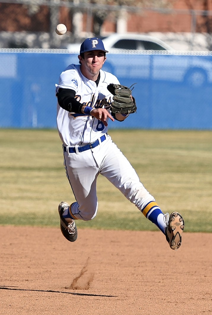 Prescott's Matt Mendibles (6) leaps and throws a ball to first base for an out Friday afternoon while playing against Desert Edge in Prescott. (Matt Hinshaw/The Daily Courier)
