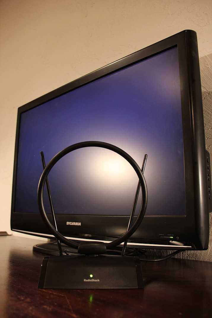 This indoor amplified HDTV antenna cost $35 at RadioShack and picks up 24 channels at Max's house.