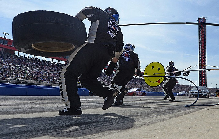 Kevin Harvick makes a pit stop during the NASCAR 400 mile auto race Sunday, March 20, at Auto Club Speedway in Fontana, Calif. Harvick ended up losing to Jimmie Johnson.