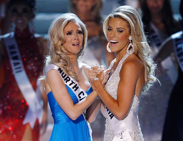 Miss North Carolina Kristen Dalton, left, and first runner-up Miss California Carrie Prejean from San Diego react after Dalton is announced Miss USA, Sunday April 19, 2009 in Las Vegas. (AP Photo/Eric Jamison)