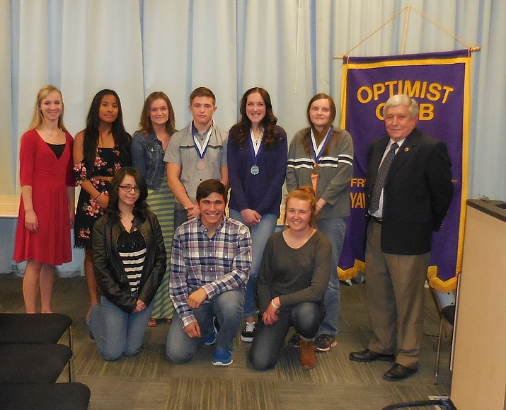 Nine of the 11 Yavapai County finalists in the Optimist International Essay Contest are back row, left to right: Zoë Dunn, Lazeth Martininez, Addison Wells, Kendall Foster (third place), Natalie Ashley Malloy (second place), Tabitha Sanders (first place), Dr. Butch Miller, President Optimist Club of Yavapai County; and front row: Emily Jolly, Jared Chavez, Tayhlar Tenney.