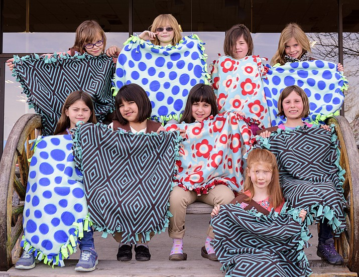 A Prescott Girl Scout Troop recently made fleece blankets for cats and dogs for United Animal Friends to be distributed through its Community Pet Food Bank.