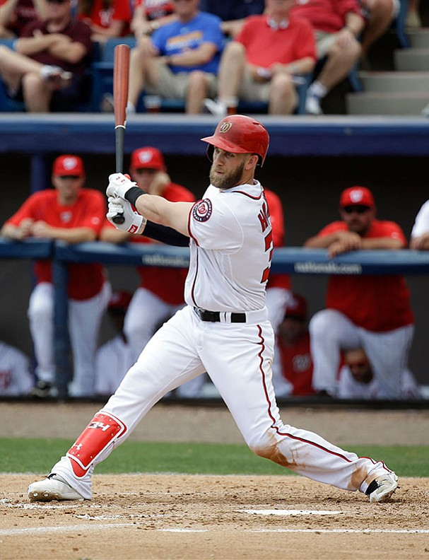 Washington Nationals' Bryce Harper bats against the St. Louis Cardinals in a spring training baseball game, Sunday, March 13, in Viera, Fla.