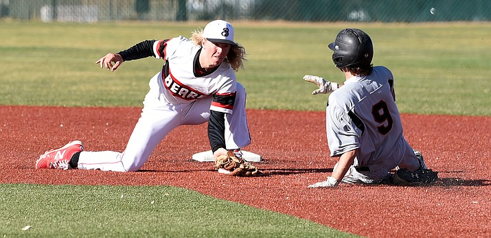 Bradshaw's Cohen Heckethorn (2) waits to tag out Desert Edge's Matthew Dacey (9) as he slides into second base Tuesday afternoon in Prescott Valley. (Matt Hinshaw/The Daily Courier)