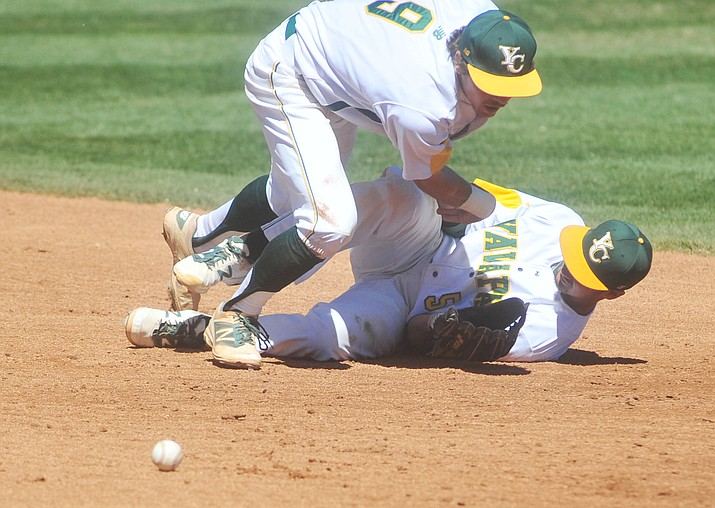 Yavapai's Dylan Enwiller and Turtle Kuhaulua collide trying to field a fly ball in the first game Tuesday afternoon, March 22.