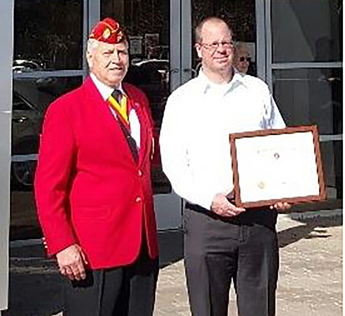 "Copper State Detachment Commandant Bob Wallace and Lamb Chevrolet Cadillac General manager Ed Walsh with the ""Stewart Fraiser Patriotism Award."""