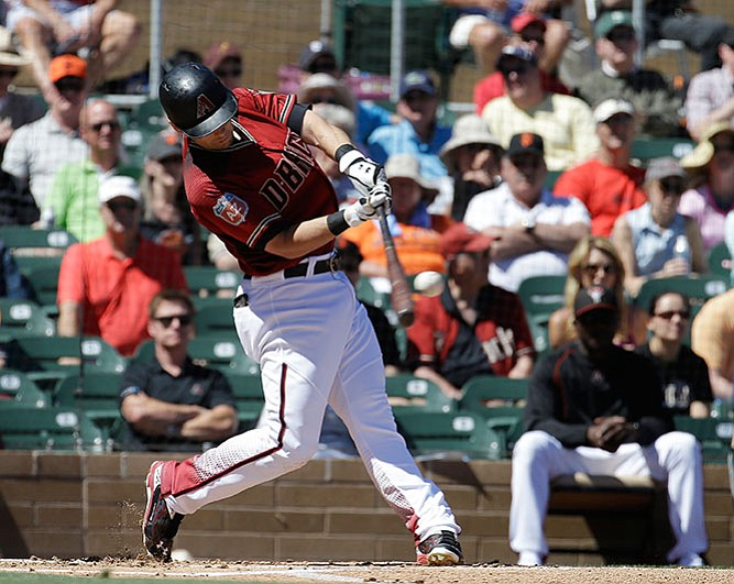 Arizona Diamondbacks' Chris Owings hits a solo home run against the San Francisco Giants during their spring training baseball game Wednesday, March 23, in Scottsdale.