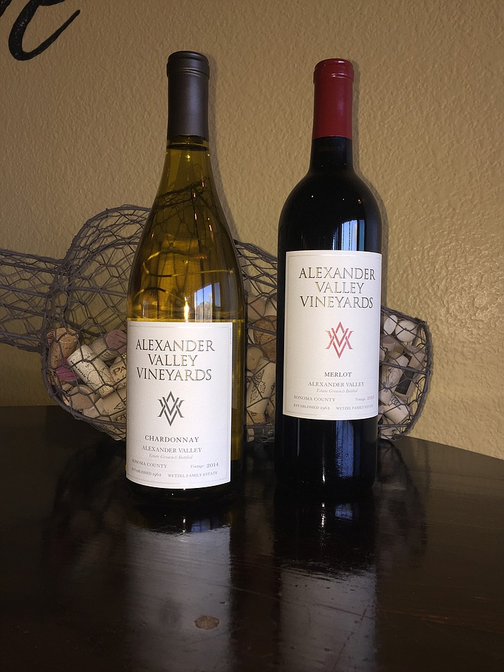 Bottles of Alexander Valley Vineyards Chardonnay and Merlot, available at Prescott Crush Wine Cafe for $9 off in-house bottle purchases.