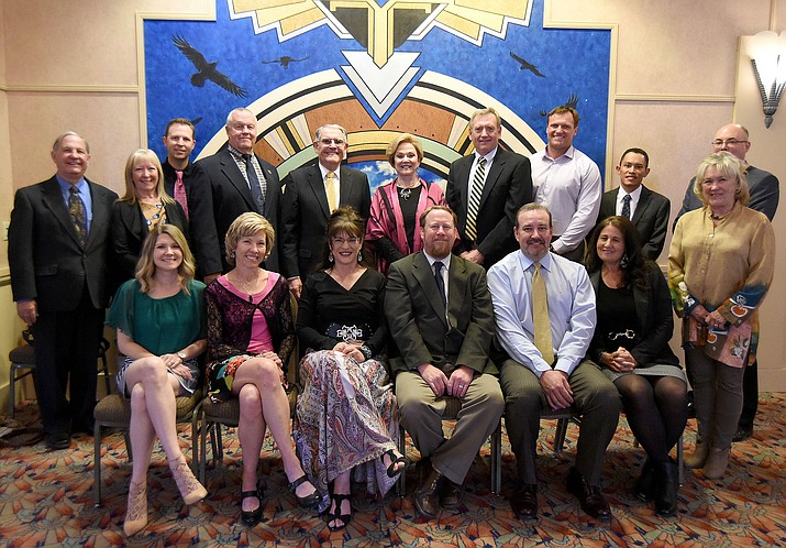 Representatives of the Arizona Community Foundation of Yavapai County, the Margaret T. Morris Foundation and the James Family Foundation gather for a photo with recipients of their first combined grant, which will invest $450,000 in early childhood literacy at PUSD schools in the next three years Thursday evening March 24, 2016 during an ACF gathering at the Hassayampa Inn. (Matt Hinshaw/The Daily Courier)