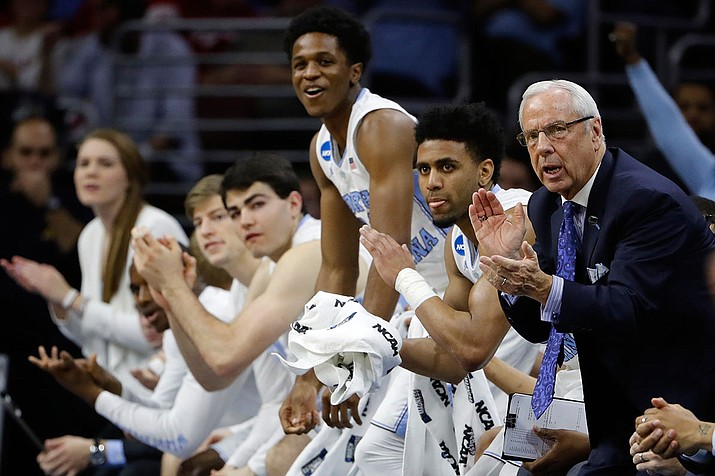 North Carolina coach Roy Williams and players applaud during the first half of the team's game against Indiana in the regional semifinals Friday in Philadelphia.