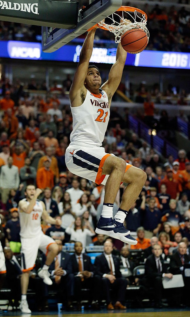 Virginia's Isaiah Wilkins (21) dunks during the second half against Iowa State in the regional semifinals of the NCAA Tournament on Friday in Chicago. The Cavaliers defeated Iowa State 84-71 to advance to Elite 8.
