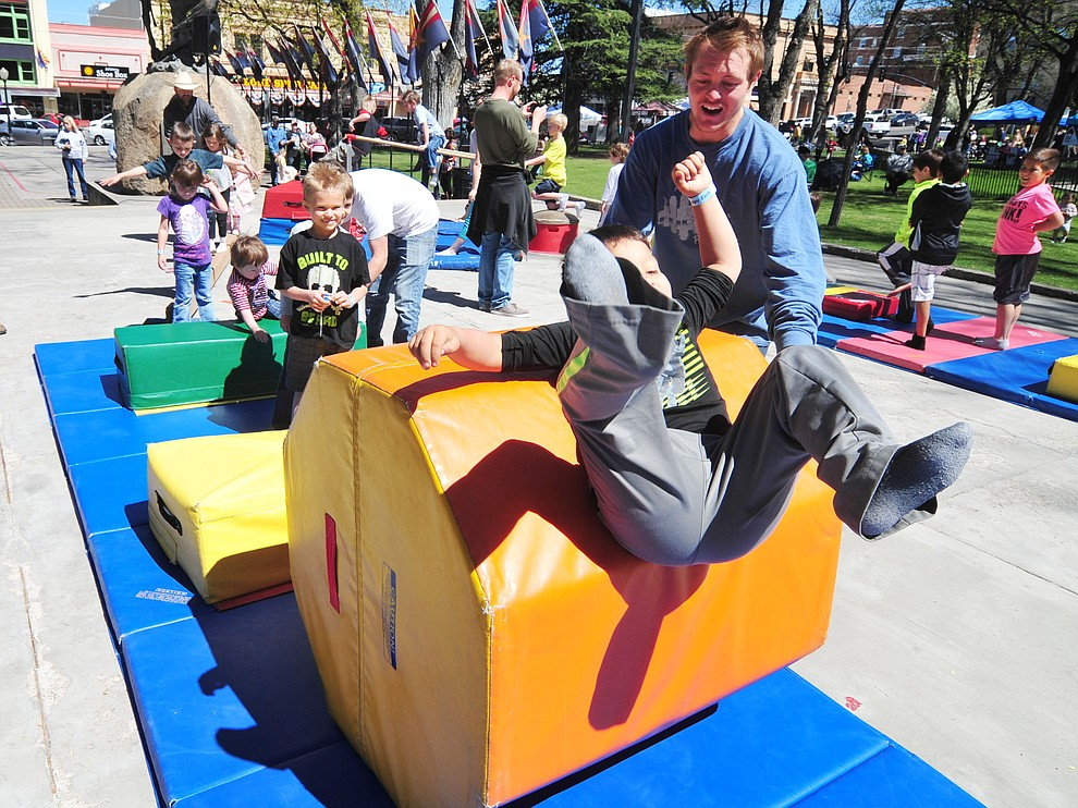 Eduardo Arguelles, six from Prescott Valley, enjoys the Flip City Gymnastics obstacle course during the Great Prescott Easter Egg Hunt Saturday morning on the Yavapai County Courthouse Plaza.(Les Stukenberg/The Daily Courier)