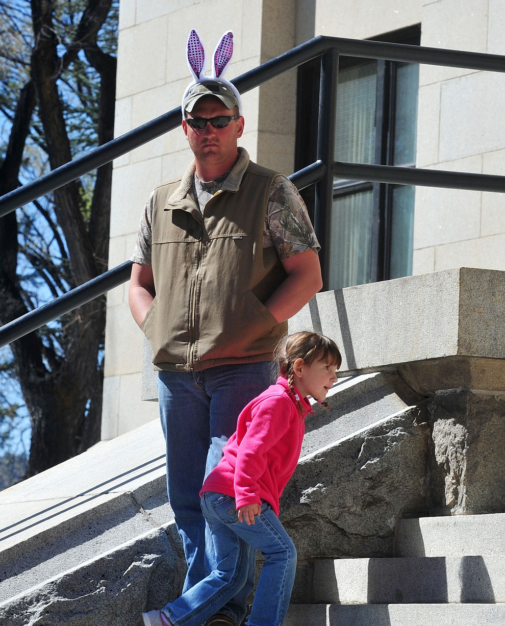Jimmy Garrett got hs ears on for his daughter Sadie during the Great Prescott Easter Egg Hunt Saturday morning on the Yavapai County Courthouse Plaza.(Les Stukenberg/The Daily Courier)