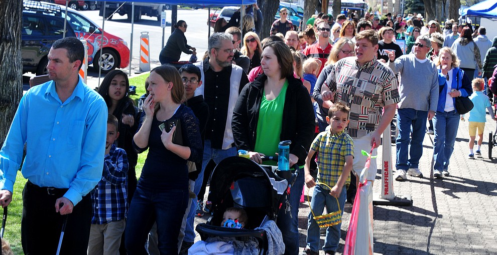 People wait in line to buy their wrist bands during the Great Prescott Easter Egg Hunt Saturday morning on the Yavapai County Courthouse Plaza.(Les Stukenberg/The Daily Courier)