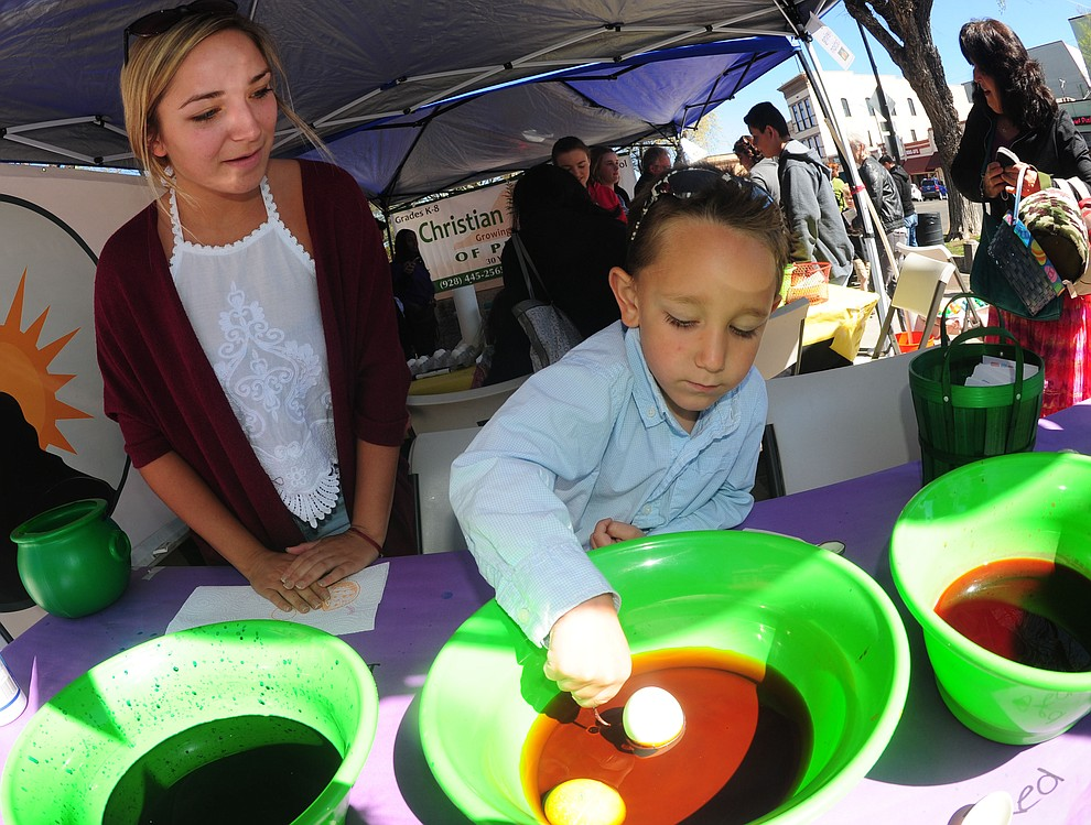 Tyler Donovan with his sister Sarah colors an egg during the Great Prescott Easter Egg Hunt Saturday morning on the Yavapai County Courthouse Plaza.(Les Stukenberg/The Daily Courier)