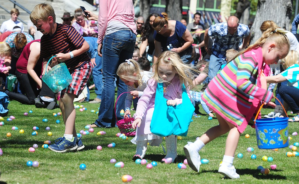 Kids grab their eggs during the Great Prescott Easter Egg Hunt Saturday morning on the Yavapai County Courthouse Plaza.(Les Stukenberg/The Daily Courier)