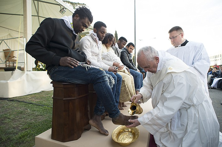 Pope Francis washes the foot of a man during the foot-washing ritual at the Castelnuovo di Porto refugees center, near Rome, Thursday, March 24. The pontiff washed and kissed the feet of Muslim, Orthodox, Hindu and Catholic refugees Thursday, declaring them children of the same God, in a gesture of welcome and brotherhood at a time when anti-Muslim and anti-immigrant sentiment has spiked following the Brussels attacks.