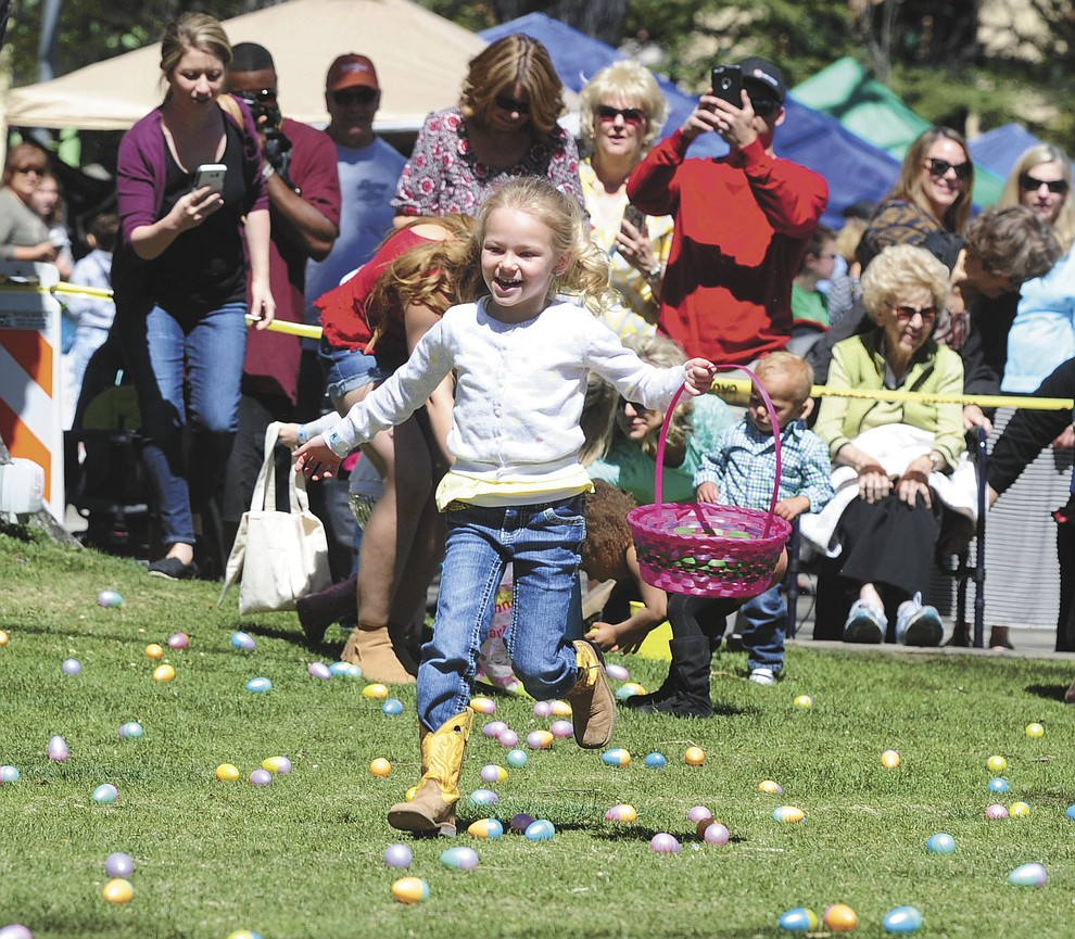 Four and unders head out to collect eggs during the Great Prescott Easter Egg Hunt Saturday morning on the Yavapai County Courthouse Plaza.(Les Stukenberg/The Daily Courier)