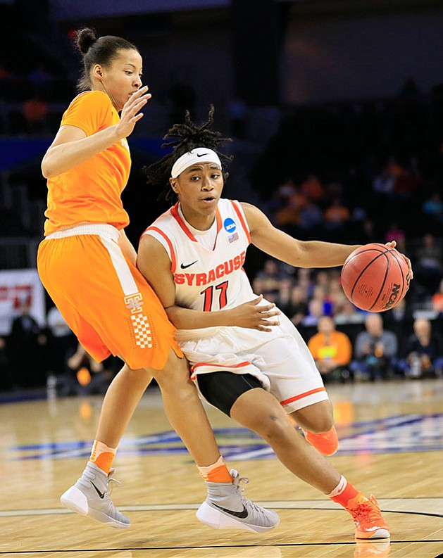 Syracuse guard Cornelia Fondren drives past Tennessee center Nia Moore during their regional final women's college basketball game in the NCAA Tournament, Sunday, March 27, in Sioux Falls, S.D.