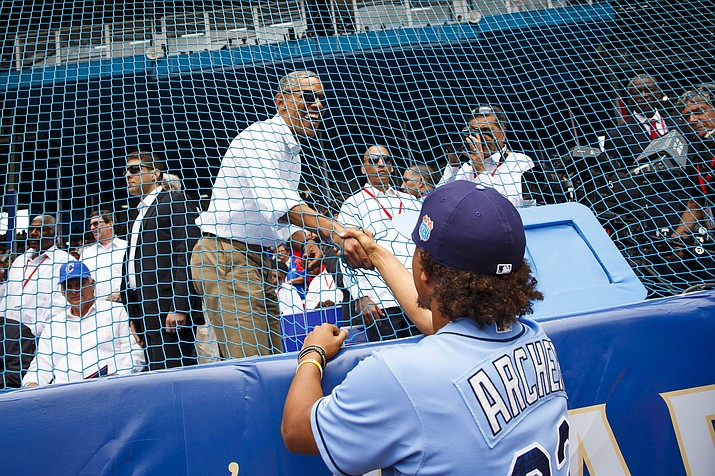 Tampa Bay Rays starting pitcher Chris Archer (22) shakes hands with Barack Obama before the game between the Tampa Bay Rays and the Cuban national team in Havana, Cuba, Tuesday, March 22.