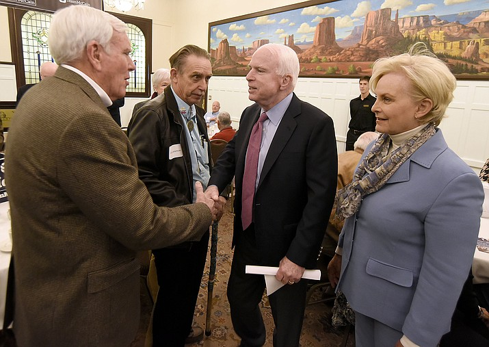 Sen. John McCain shakes Prescott Mayor Harry Oberg's hand while Cindy McCain and Councilman Jim Lamerson look on Tuesday morning March 29, 2016 at the Hassayampa Inn while hosting a coffee reception in Prescott. (Matt Hinshaw/The Daily Courier)