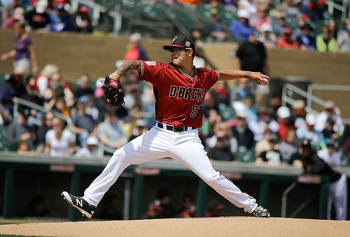 Arizona Diamondbacks starting pitcher Anthony Banda throws against the Colorado Rockies during their spring training baseball game Tuesday, March 29, in Scottsdale.