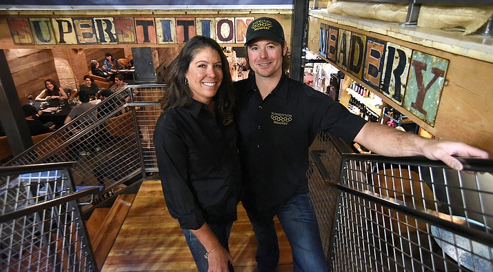 Jennifer and Jeff Herbert owners of the Superstition Meadery stand in the stairwell of their business Wednesday evening March 30, 2016.  The downtown Prescott business is expanding, the Herbert's are opening a production facility in the Prescott Airpark. (Matt Hinshaw/The Daily Courier)