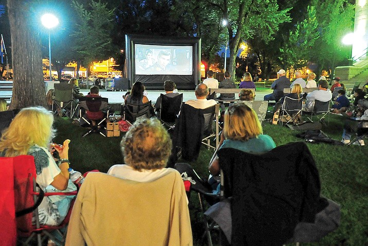 "Friends, family and movie-goers enjoy a screening of the 2005 family comedy ""Yours, Mine and Ours"" staring Dennis Quaid and Rene Russo at the courthouse plaza as part of the 2012 Summer Concert Series."