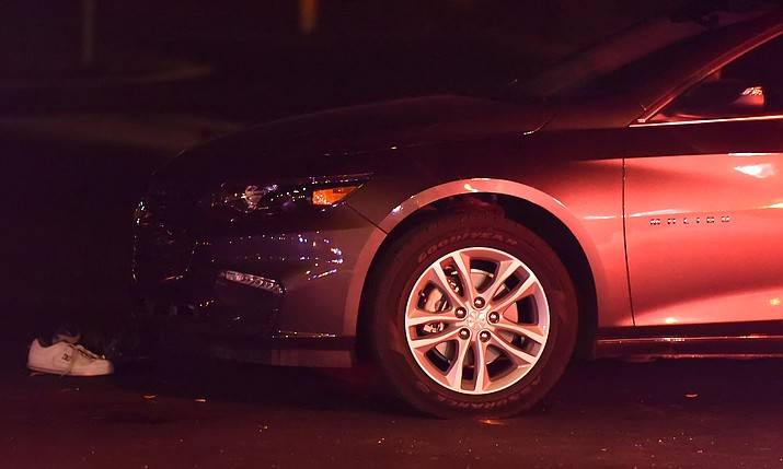 A shoe rests near the front of a car that struck and pinned a 20-year-old-man who was walking across a crosswalk Friday night April 1, 2016 at the intersection of Lake Valley Rd. and Lakeshore Dr. in Prescott Valley. (Matt Hinshaw/The Daily Courier)