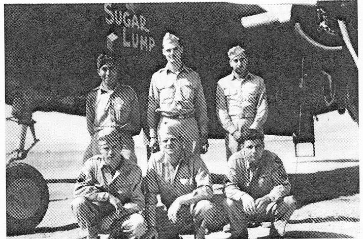 Lt. Gilbert D. Orrantia at Souk El Arba, North Africa, far left, back row.
