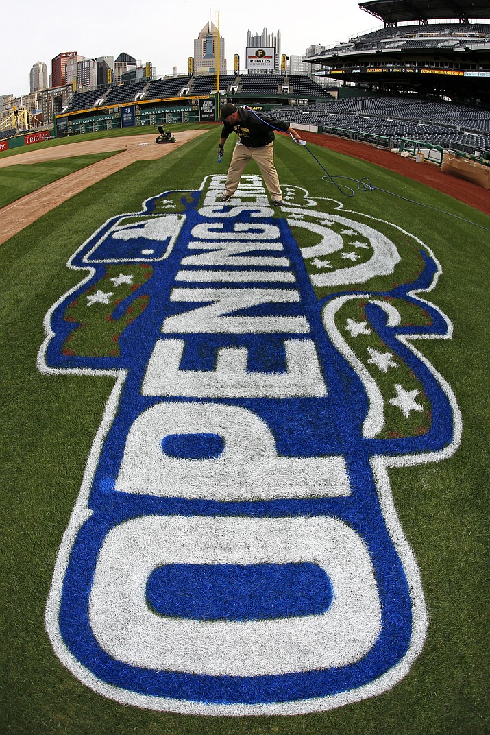 PNC Park ground crew member Matt Gerhardt paints the field, Wednesday, March 30, 2016, in preparation for the 2016 Major League Baseball season opening series between the Pittsburgh Pirates and St. Louis Cardinals, Sunday, April 3, 2016 in Pittsburgh.