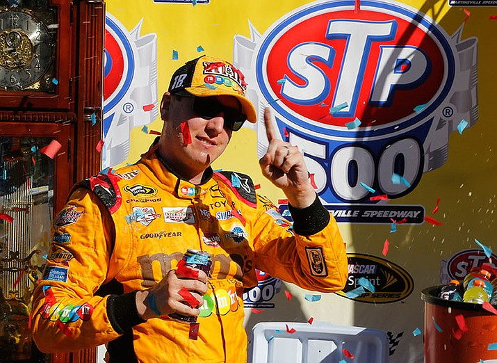 Kyle Busch celebrates winning the Sprint Cup auto race at Martinsville Speedway on Sunday, April 3, in Martinsville, Va.