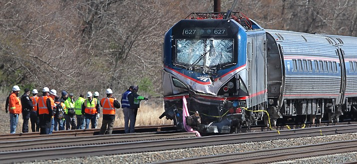 Amtrak investigators inspect the deadly train crash in Chester, Pa., Sunday, April 3. The Amtrak train struck a piece of construction equipment just south of Philadelphia causing a derailment.